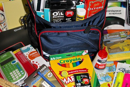 school bags with stationery and textbooks